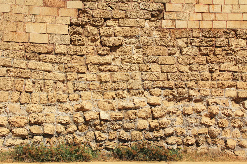 Stone Wall texture Caesarea Maritima National Park. Stone wall background texture of ruins in Caesarea Maritima National Park, a city and harbor built by Herod stock image