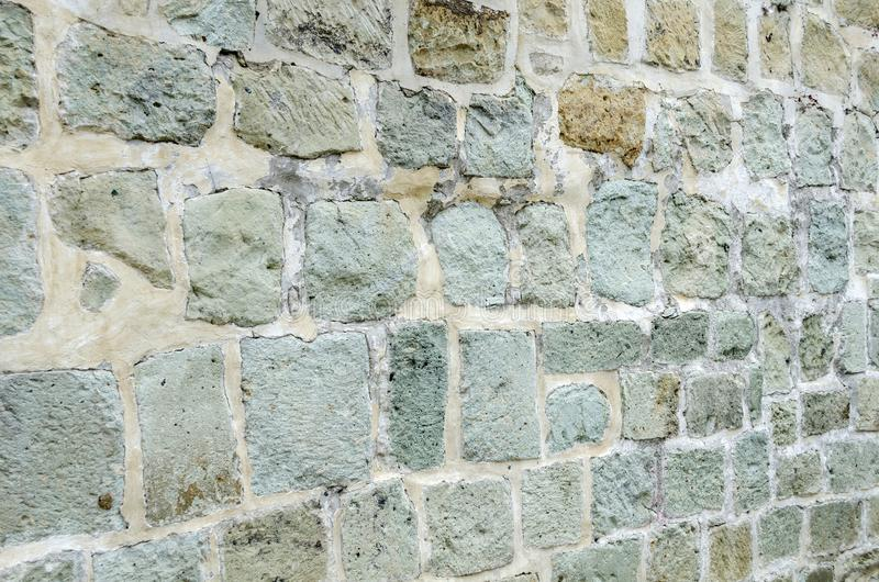Stone wall texture. Green quarry wall in Oaxaca, Mexico. Stone wall texture royalty free stock photos