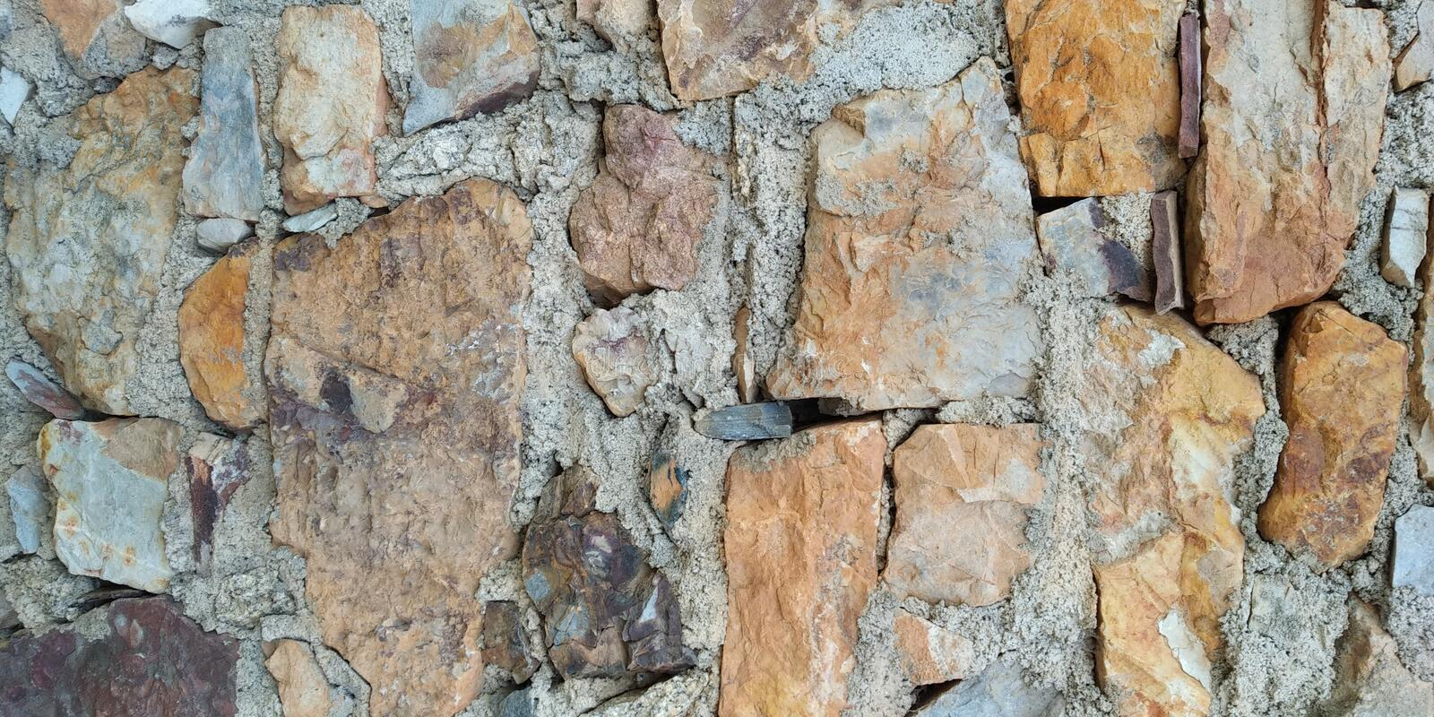 Old Stone Wall of House Texture. Stone Wall Texture. Grey Brown. Parede de Pedra stock photo