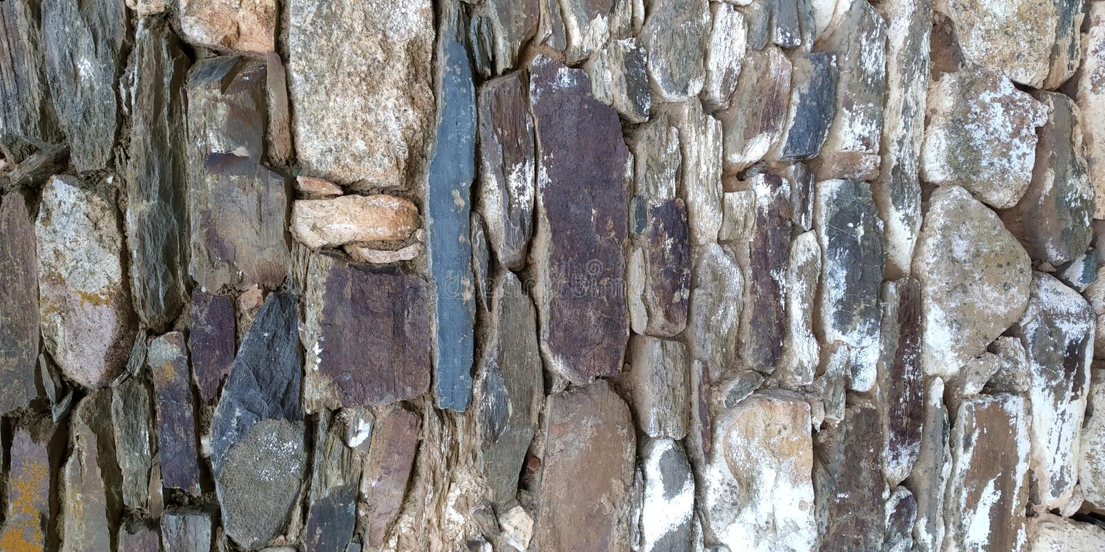 Stone Wall Texture of House. Stone Wall Texture. Grey Brown. Parede de Pedra royalty free stock photography