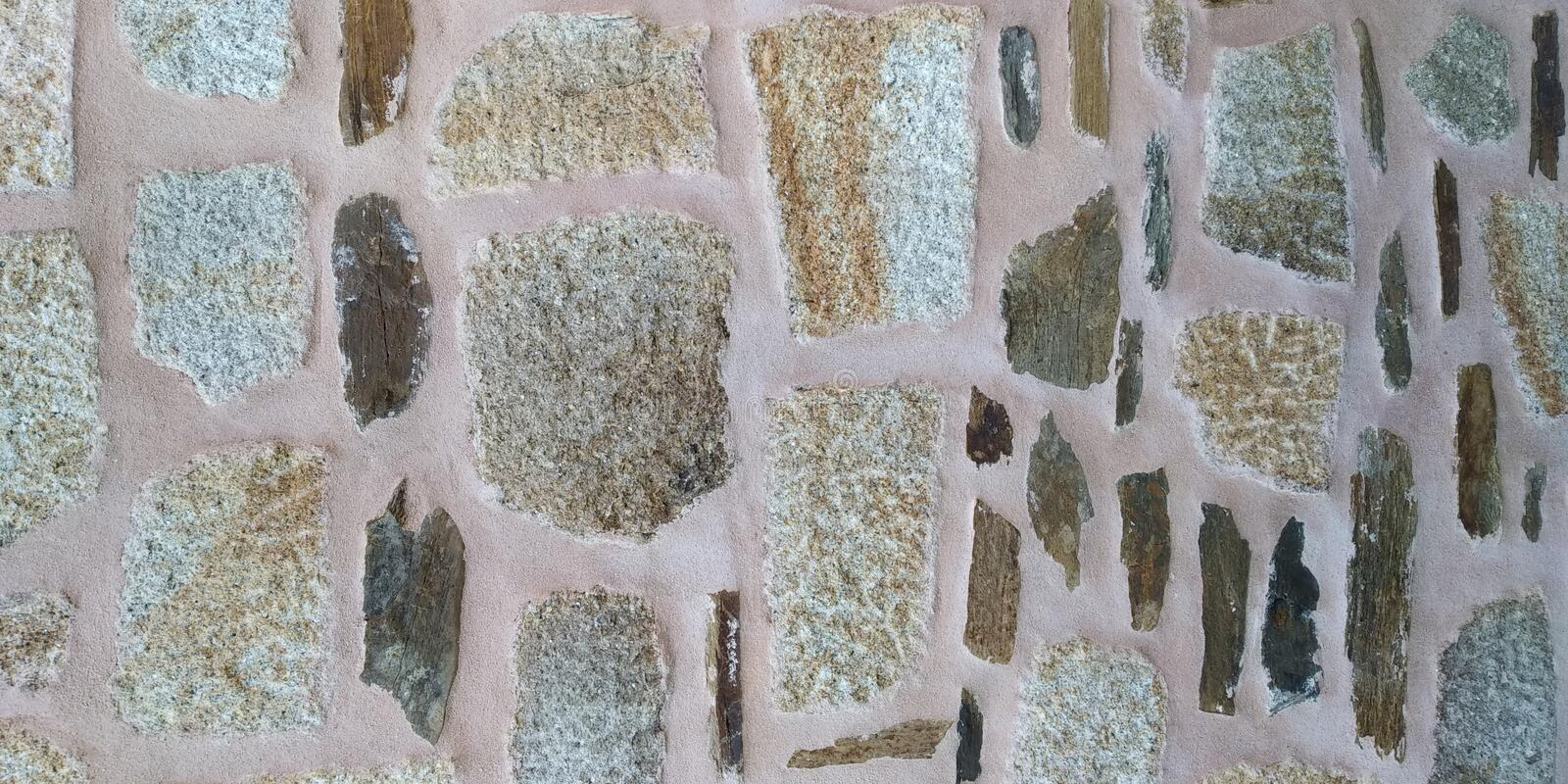 Stone Wall Texture of House. Stone Wall Texture. Grey Brown. Parede de Pedra royalty free stock photo
