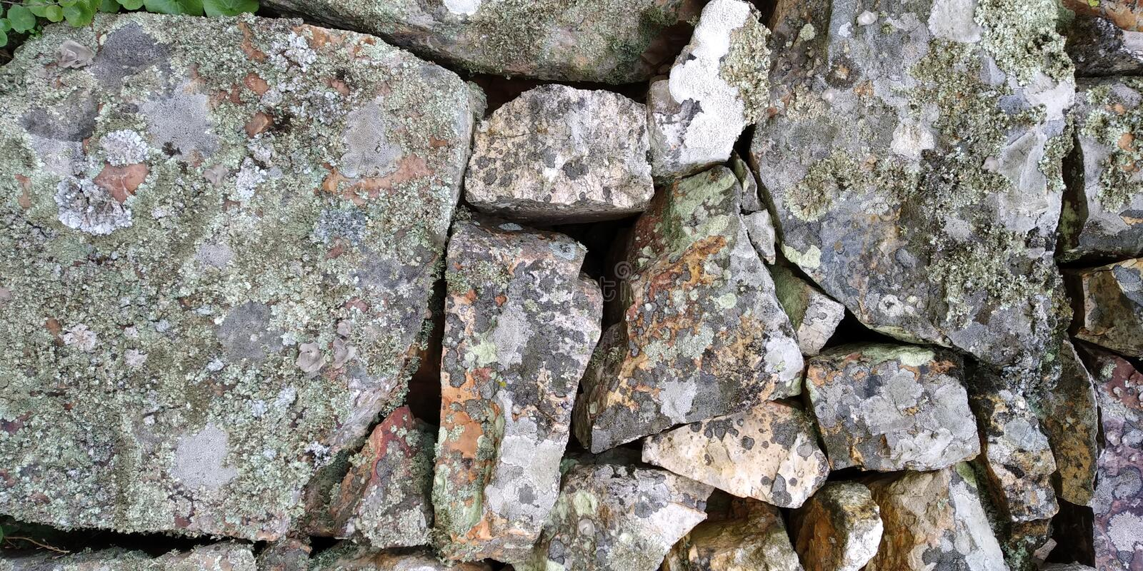 Old Stone Wall of House Texture. Stone Wall Texture. Grey Green. Parede de Pedra stock photography