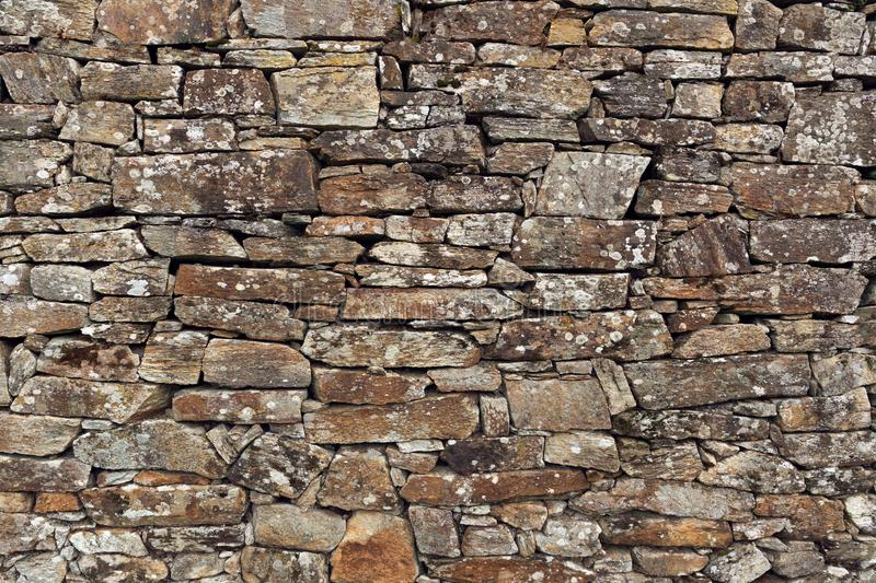 Stone wall background. Ancient wall of dry masonry. Stone wall texture in the historic city of Santiago de Compostela royalty free stock image