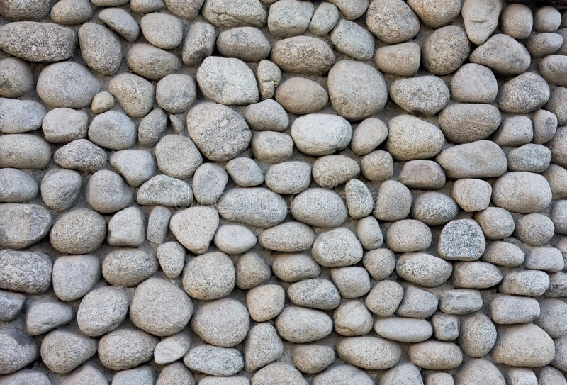 Stone wall texture from river stock photo