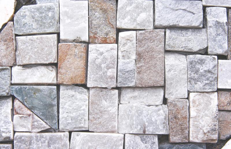 Stone wall texture in square pattern abstract for background. Close up Stone wall texture in square pattern abstract for background royalty free stock images