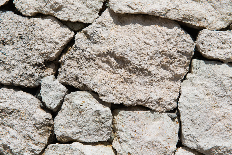 Stone wall texture. Stonework, masonry, background and texture concept - grainy stone wall royalty free stock photos