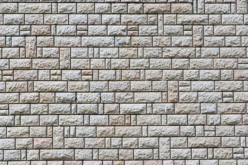 Stone wall texture. White wall of stone with black joints texture royalty free stock photo