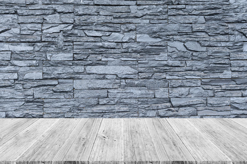 Stone wall texture with wood terrace. Stone wall texture background surface natural color with wood terrace stock photography