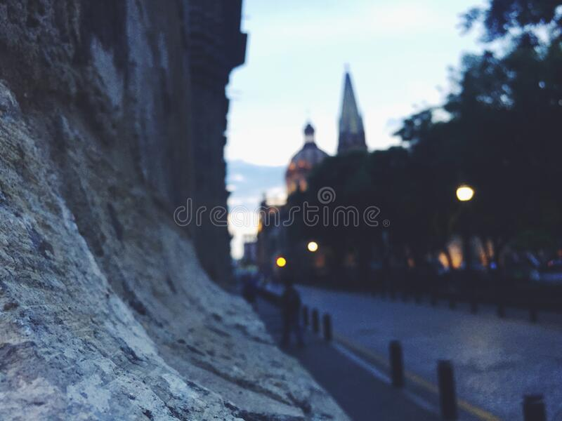 Stone wall in town stock image