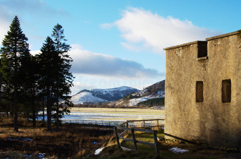 Stone wall in a winter setting stock photography
