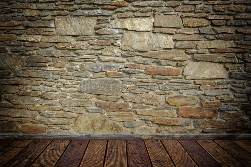 Stone wall and wooden floor. Old stone wall with wooden floor background stock images