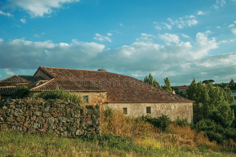 Stone wall and a worn house in hilly landscape at Avila stock photo