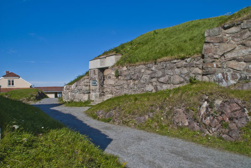 Stone walls at fortress (enveloppen 2). Around fredriksten fortress in halden is it built, a number of stone walls and picture shows a part of enveloppen 2 royalty free stock photography