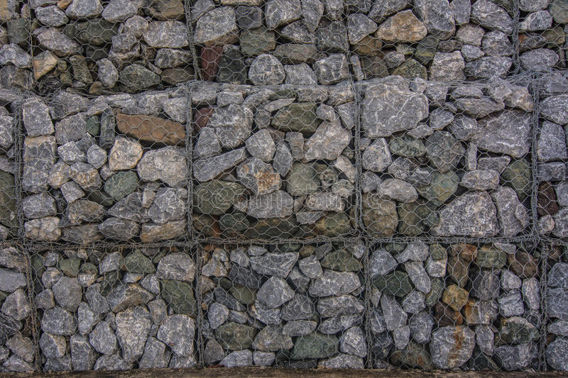 Stone walls in net prevent soil and stone slides. stock images