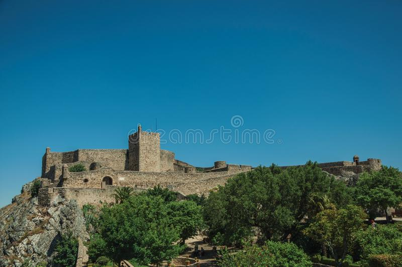 Stone walls and tower of Castle over hill near garden at Marvao stock photo