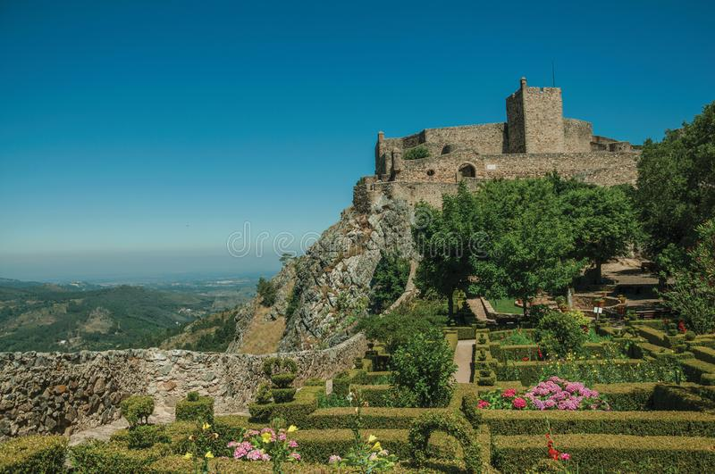 Stone walls and tower of Castle over hill near garden at Marvao stock photos