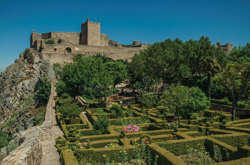 Stone walls and tower of Castle over hill near garden at Marvao royalty free stock photography