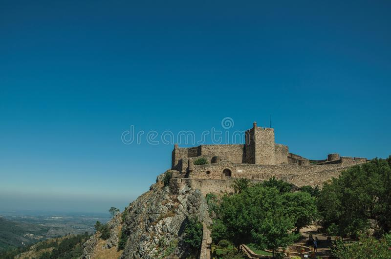 Stone walls and tower of Castle over hill near garden at Marvao royalty free stock photos