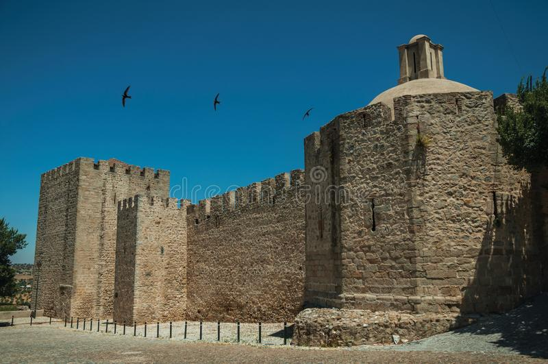 Stone walls and towers in the front facade of the Elvas Castle royalty free stock images