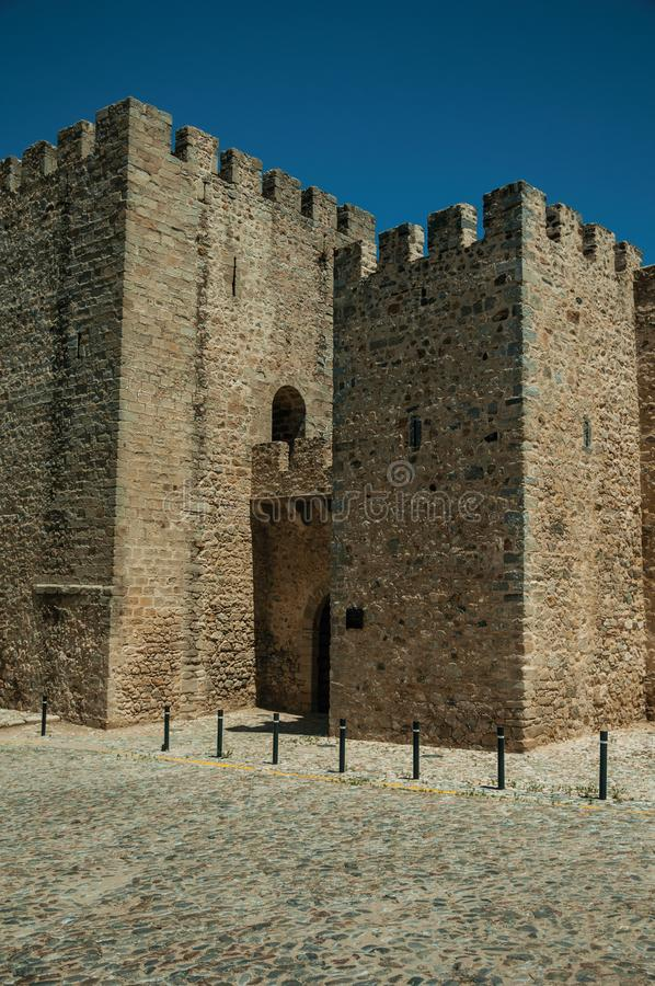 Stone walls and towers in the front facade of the Elvas Castle stock photography