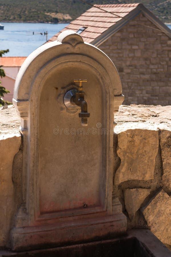 Stone washbasin in a park, Primosten, Croatia stock photo