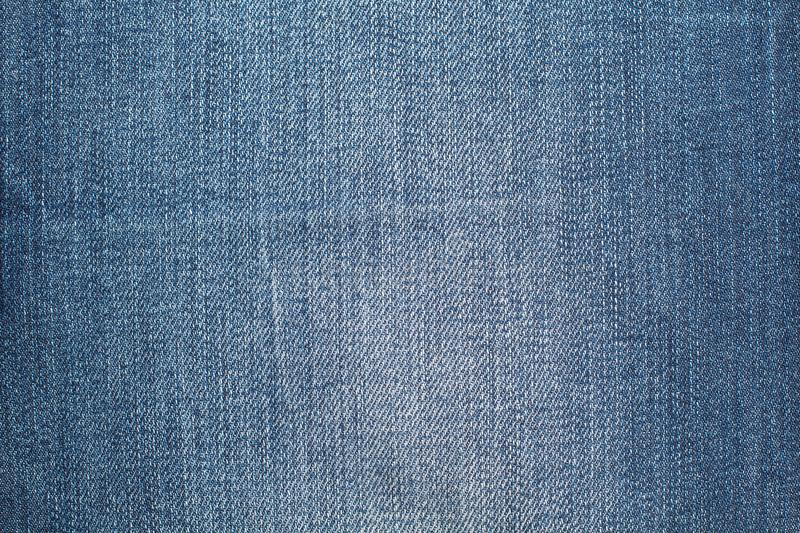 Stone washed blue jeans texture royalty free stock photos