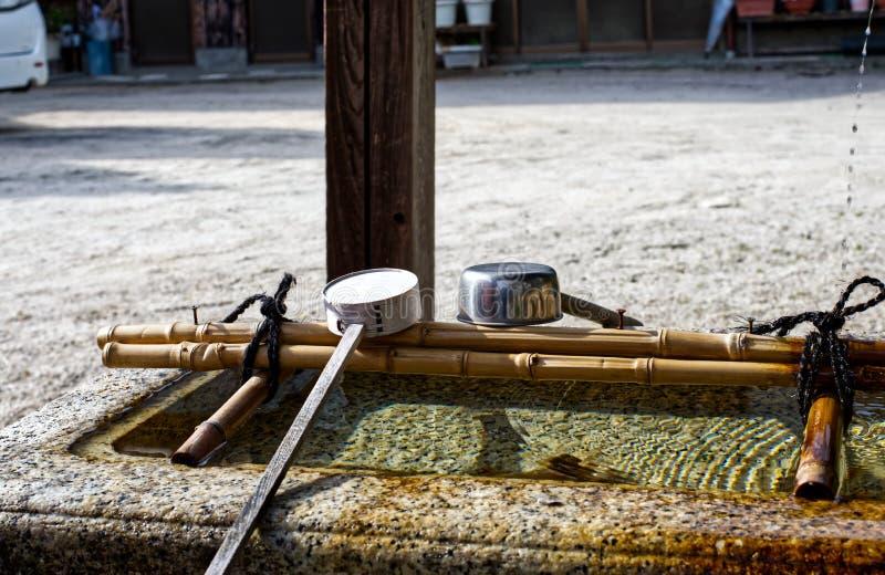 Stone water basin, Wani Ontakeyama Shrine royalty free stock photo