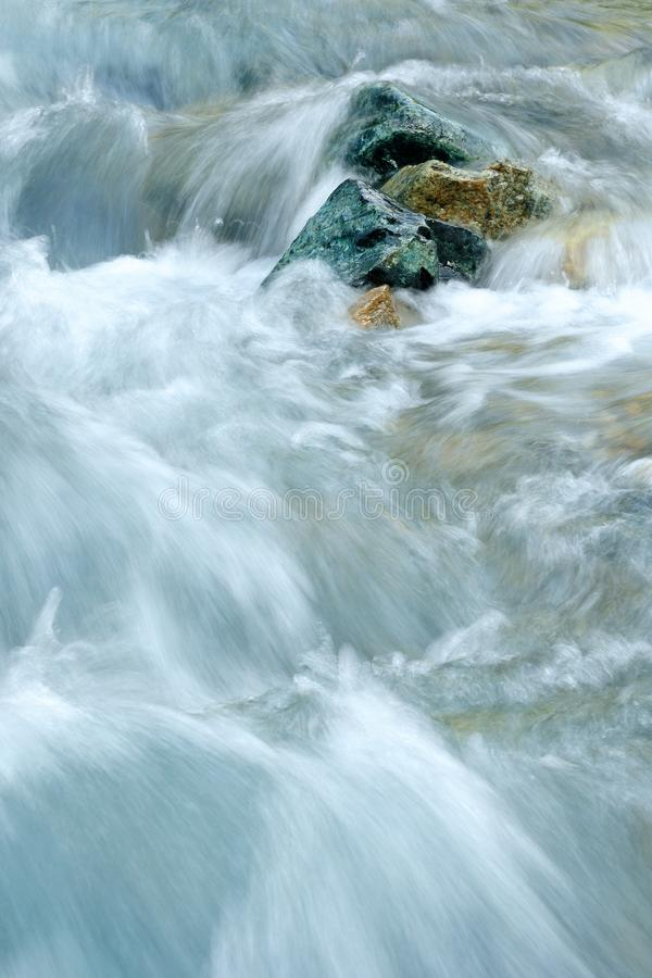 Stone in the Water. This stone i can photograph in the water from a little river in the mountains stock images
