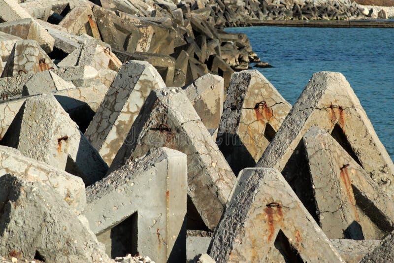 Stone wave breaker and sea royalty free stock photos