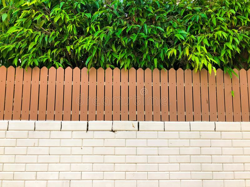 Stone with wooden fence with green lawn and landscape.  stock photography