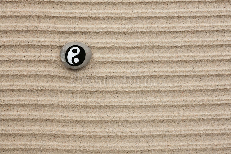 Download Stone With A Yin-yang Lies On The Sand Stock Image - Image of sign, season: 29960415