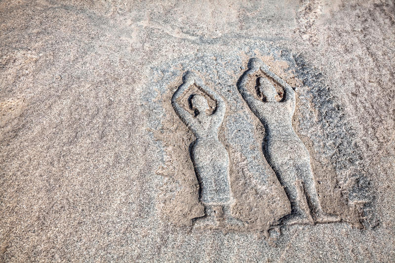 Stone with yoga people in Hampi royalty free stock photography