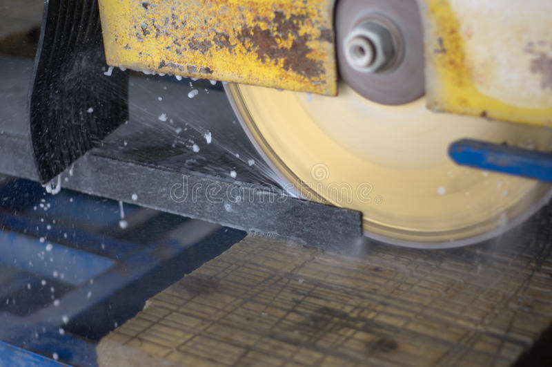 Cutting granite/marble slabs royalty free stock image