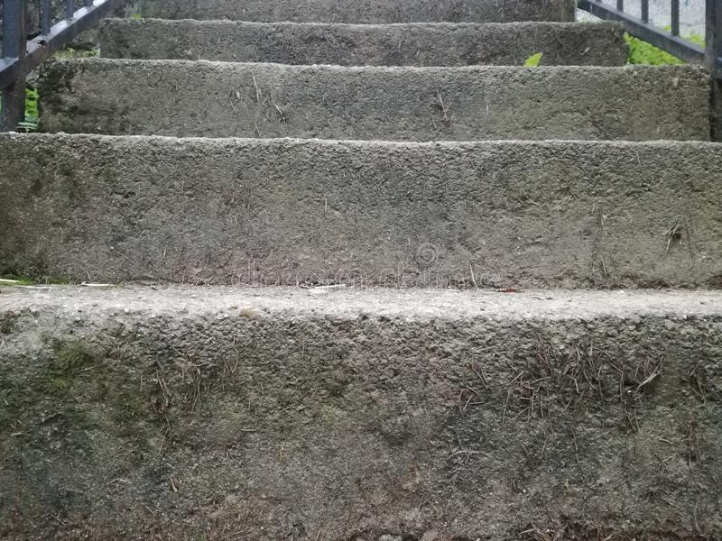 Stoned stairs. With abstract gray green and white colors, for textures or background the rock stock photography