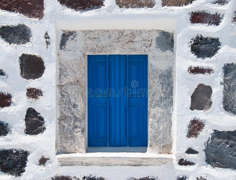Stone wall with blue window