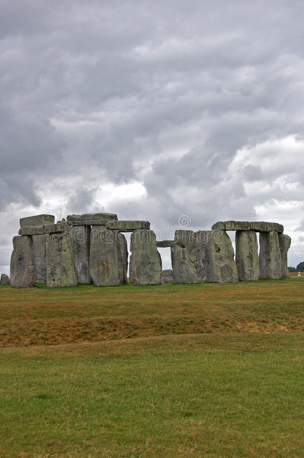 Stonehenge. An ominous sky looms over the prehistoric site Stonehenge stock images