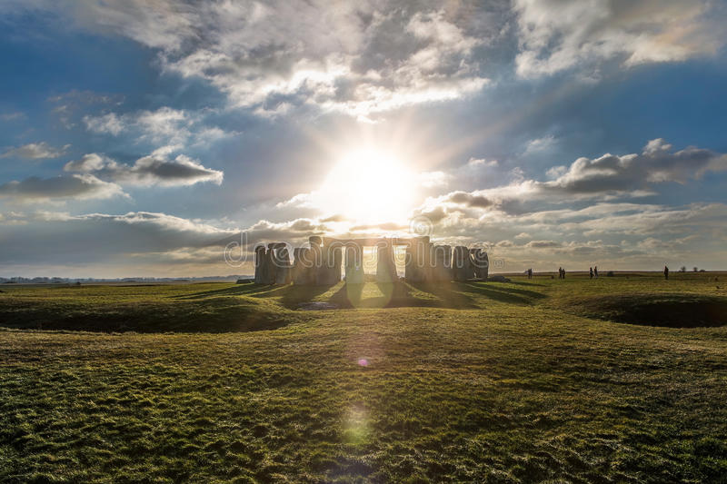 Stonehenge against the sun, Wiltshire, England stock images