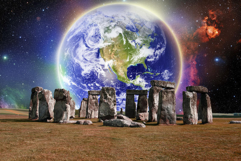 Stonehenge Earth. Stonehenge in front of a glowing Earth stock illustration