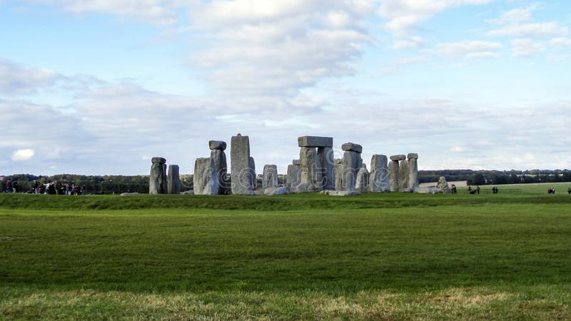 Stonehenge prehistoric monument, green grass, blue sky and clouds, panoramic view - Wiltshire, Salisbury, England. UK stock photography
