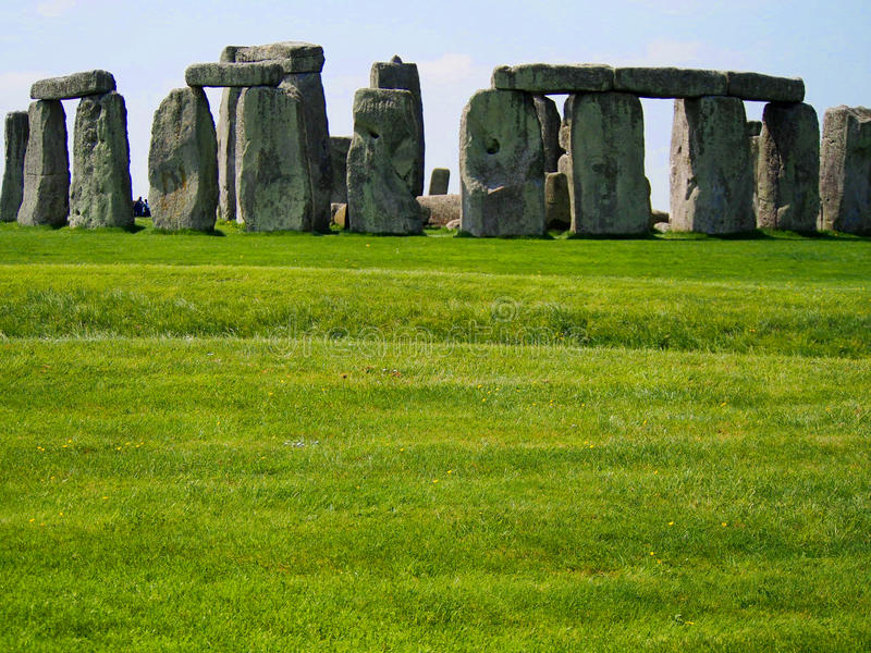 Stonehenge Ruins with Green Grass on Sunny Day royalty free stock image