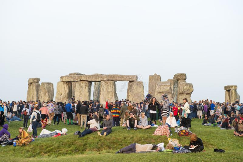 Stonehenge summer solstice. Sunrise summer solstice at the prehistoric monument of Stonehenge surrounded by crowds of people, in Wiltshire, England, UK stock image