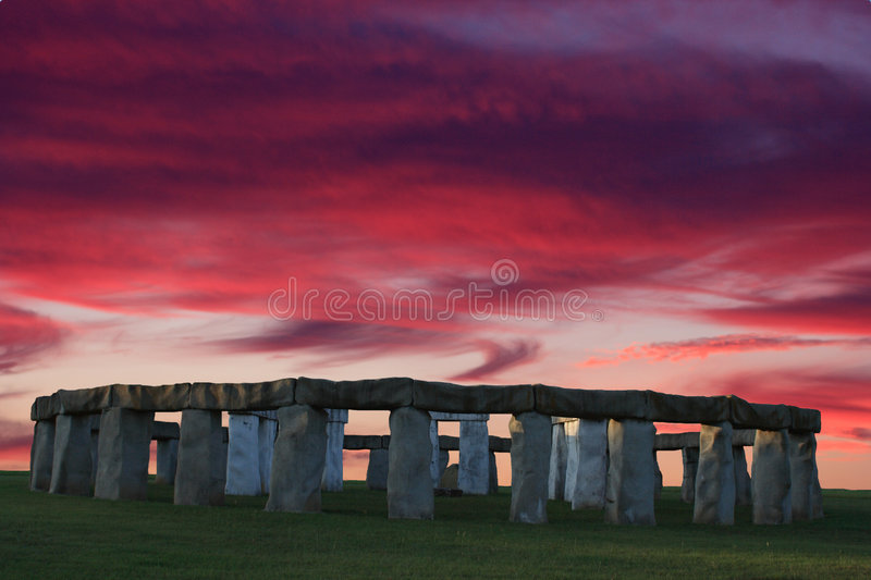 Stonehenge Sunset. Replica of Stonehenge with a colorful sunset in the background stock photos