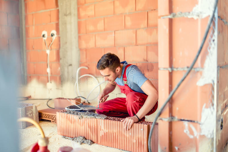Stonemason building walls, construction engineer and worker on site stock photos