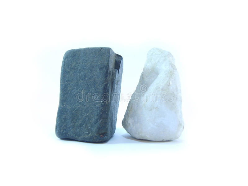 Stones. Two various stones - black and white royalty free stock photography