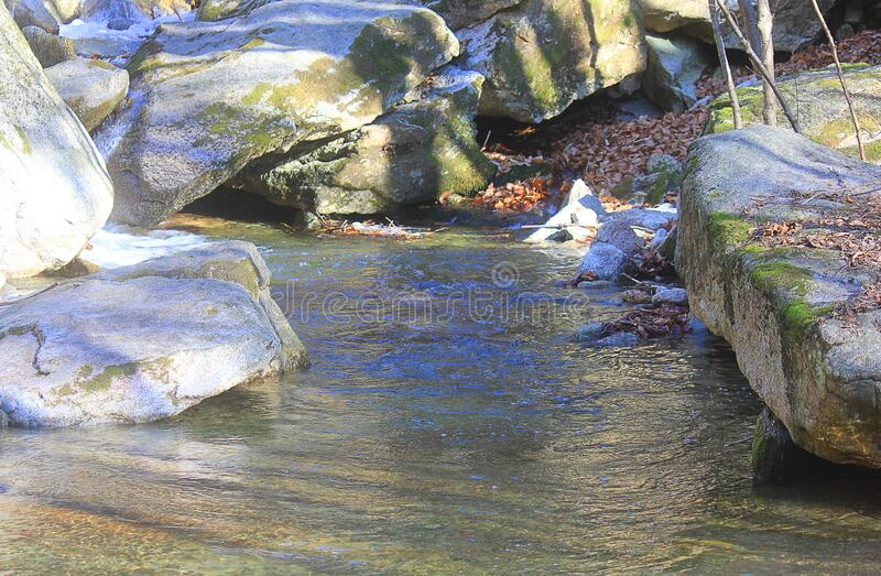 Stones around the stream stock image