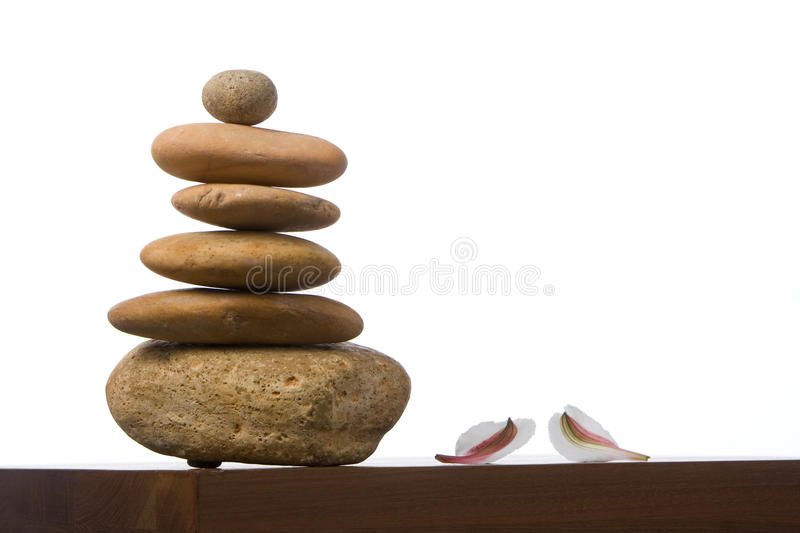 Stones in balance. On white background royalty free stock images