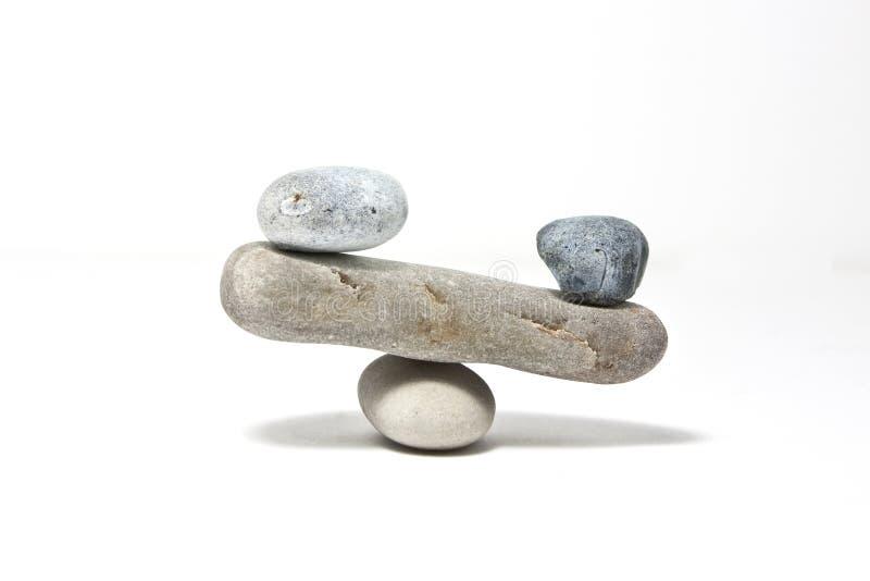 Stones balance. On flat stone bridge on white royalty free stock photography