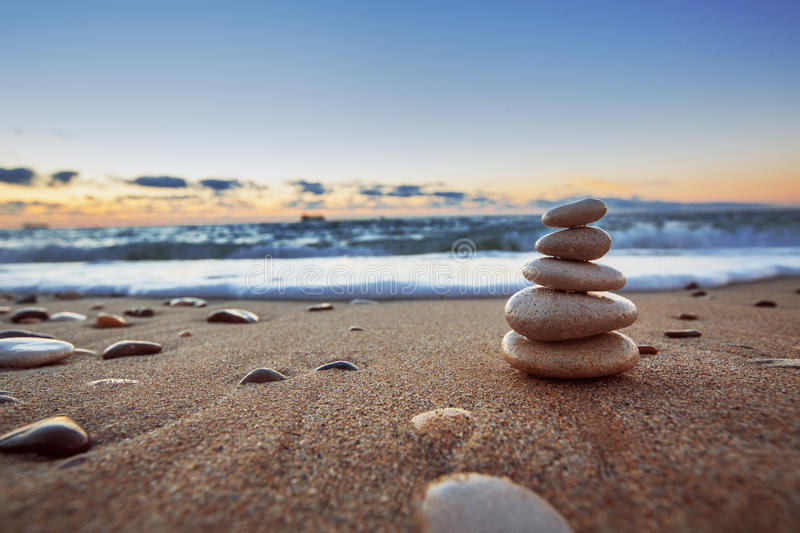 Stones balance. On beach, sunrise shot
