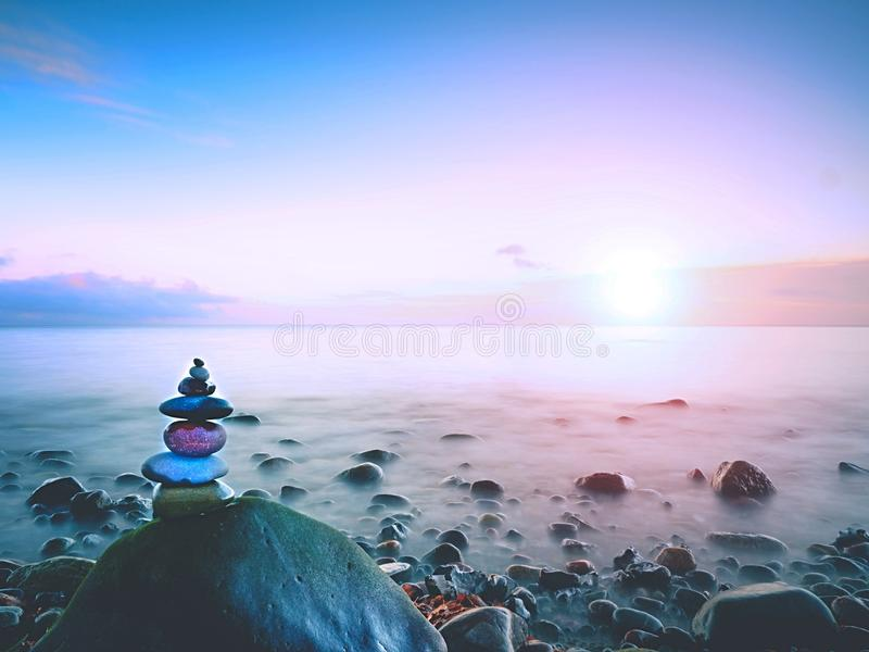 Stones balance on rounded stone at sea, concept inspiration. Beautiful landscape background. Zen-like royalty free stock photo