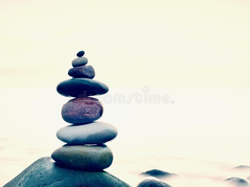Stones balance on rounded stone at sea, concept inspiration. Beautiful landscape background. Zen-like stock photos